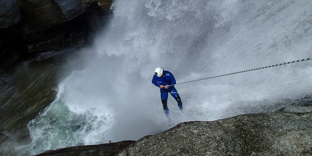 abseiling in massive waterflow in iragna canyon
