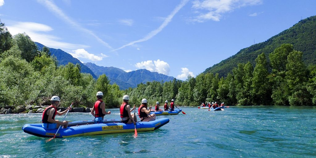school group paddles their own rafts on ticino river