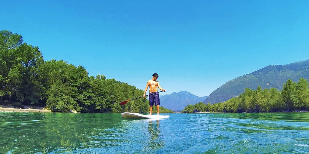 crystal clear water with standup paddleboarder